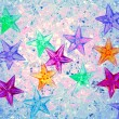 Christmas colorful stars on blue ice — Stock Photo #6999351