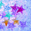 Christmas colorful stars on blue ice — Stock Photo #6999413