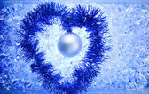 Christmas silver bauble tinsel heart — Stock Photo