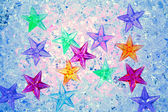 Christmas colorful stars on blue ice — Stock Photo