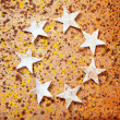 Christmas stars background on recycle paper — Stockfoto