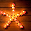 Christmas candles pentagram star on wood — Stock Photo