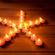 Christmas candles pentagram star on wood — Stock Photo #7000569