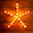 Stock Photo: Christmas candles pentagram star on wood