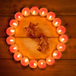 Stock Photo: Chirstmas candles circle over wood and symbol