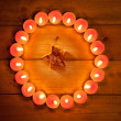 Chirstmas candles circle over wood and symbol - Stock Photo