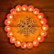 Chirstmas candles circle over wood and symbol — Stock Photo #7000679