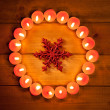 Chirstmas candles circle over wood and symbol — Stock Photo #7000719