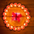 Chirstmas candles circle over wood and symbol — Stock Photo #7000733