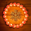 Chirstmas candles circle over wood and symbol — Stock Photo #7000748
