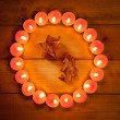 Chirstmas candles circle over wood and symbol — Stock Photo #7000769