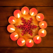Royalty-Free Stock Photo: Chirstmas candles circle over wood and symbol