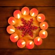 Chirstmas candles circle over wood and symbol — Stock Photo #7001028