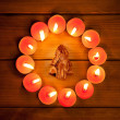 Chirstmas candles circle over wood and symbol - Zdjcie stockowe
