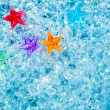 Christmas colorful glass stars on cold blue ice — Stock Photo #7001470