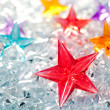 Christmas red glass star on winter ice — Stock Photo #7001640