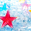 Christmas red glass star on winter ice — Stock Photo #7001744