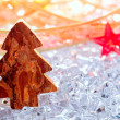 Christmas tree with bark wood on winter ice — Stock Photo