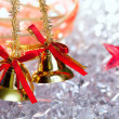 Christmas golden bells with red ribbon — Stock Photo