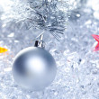 Christmas baubles silver on winter ice - Stockfoto