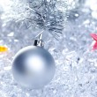 Christmas baubles silver on winter ice — Stock Photo