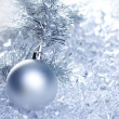 Christmas baubles silver on winter ice - Stock fotografie