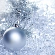 Christmas baubles silver on winter ice - Foto Stock