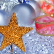 Christmas golden star symbol silver baubles - Stock Photo