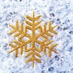 Chritmas golden snowflake symbol on ice — Stock Photo