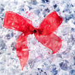 Christmas gift ribbon loop on winter ice — Stok fotoğraf
