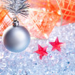 Christmas silver bauble and red ribbon on ice — Stock Photo #7002972