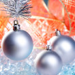 Christmas silver baubles with red ribbon on ice — Stock Photo #7002985