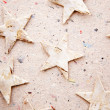Chritmas stars on recycled paper background — Stock Photo