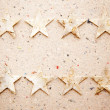 Christmas stars on recycled paper background - Stock Photo