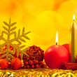 Stock Photo: Christmas golden snowflake with red candles