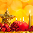 Christmas golden star with red candles — Stock Photo