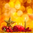 Christmas golden star with red candles - Stock Photo