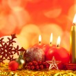 Christmas red snowflake with candles - Stock Photo