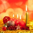 Christmas red candles on golden bokeh lights - Stock Photo