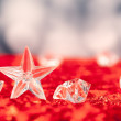 Stock Photo: Christmas crystal star on ice cubes