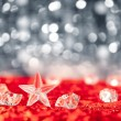 Christmas crystal star on ice cubes — Stock Photo
