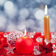 Christmas red golden candles on ice cubes - Stok fotoğraf