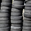 Stock Photo: Car tires pneus stacked in rows
