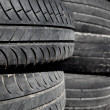 Royalty-Free Stock Photo: Car tires pneus stacked in rows