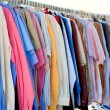 Fashion shirt rack with colorful clothes — Stock Photo #7003986