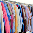 Fashion shirt rack with colorful clothes — Stock Photo