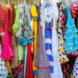 Colorful gipsy dresses in rack hanged in Spain — Zdjęcie stockowe