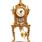 Ancient vintage brass pendulum clock — Stock Photo