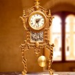 Ancient vintage golden brass pendulum clock — Stock Photo #7004056