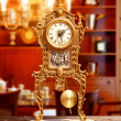 Ancient vintage brass pendulum clock — Stock Photo #7004064
